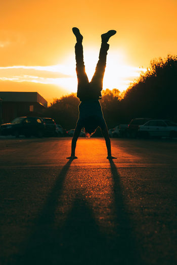 Balance Breakdancing Day Exercising Flexibility Full Length Handstand  Healthy Lifestyle Leisure Activity Lifestyles Men Nature One Person Outdoors People Real People Silhouette Skill  Sky Strength Stunt Sunset Capture Tomorrow