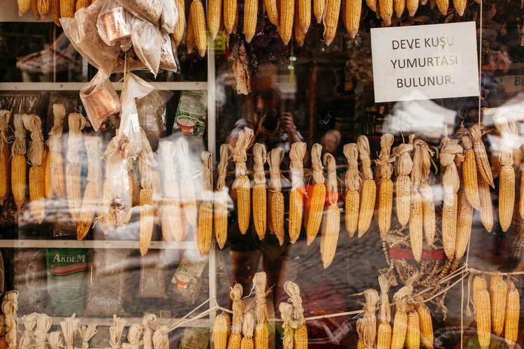 Corns with labels on window display at store