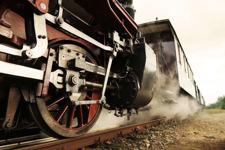 Steam train on railroad track
