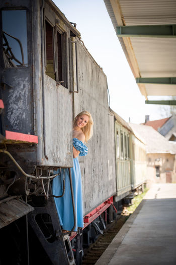 Happy Young Woman In Old Train