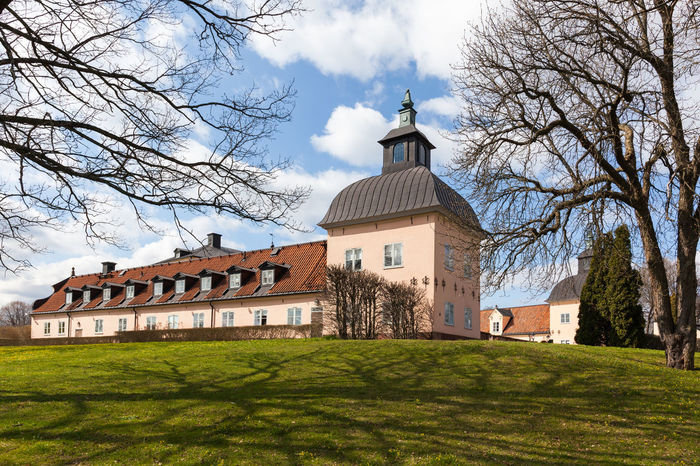 View of Hasselby Castle, located in the Hasselby gard in the west of Stockholm region. Architecture Building Castle Clouds Clouds And Sky Destination Europe Grass Hässelby Landmark Nordic Countries Scandinavia Sky Slott Spring Stockholm Stockholm, Sweden Sweden Travel Tree Trees