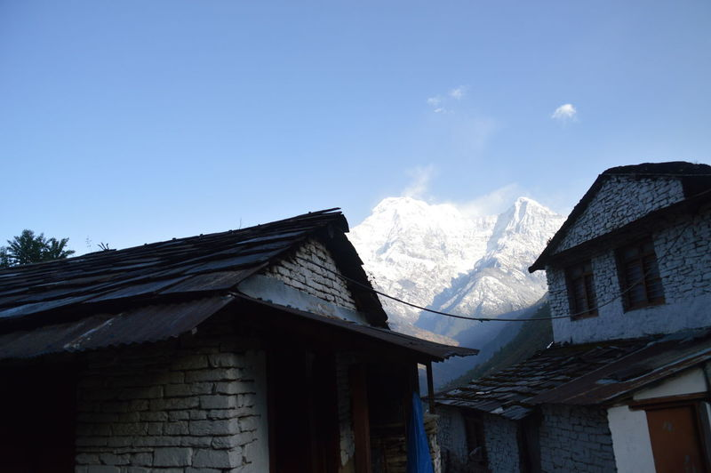 Architecture Roof Building Exterior No People Built Structure Winter Day Tradition Outdoors Tree Sky Snow Cold Temperature Annapurna Mountain Range Trek To Annapurna Nepal Travel Destinations Snow Covered Mountains Snowy Mountain In The Background