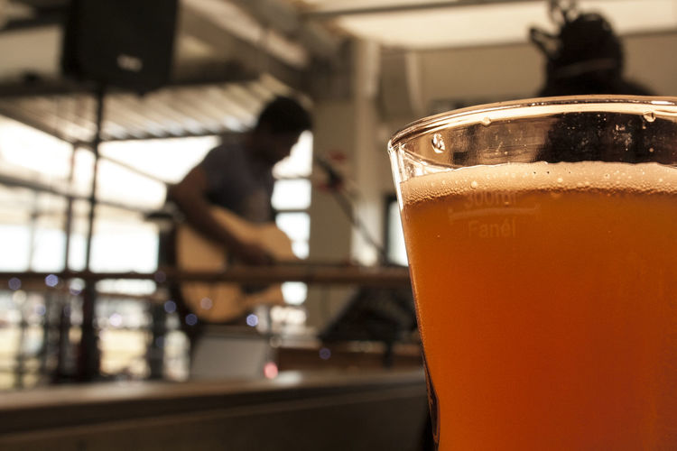 Sunday lunch, beer and music. Activity Beer Beer Time Close-up Day Drink Drinking Glass Focus Object Focus On Foreground Freshness Guitar Guitarist Indoors  Lunch Music Musician Port Elizabeth Refreshment Restaurant Singer  Enjoy The New Normal