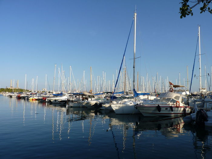 Yachts Moored On Sea Against Clear Blue Sky