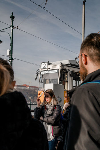 Tram Listening Walking Tour Tour Briefing Portrait Portrait Of A Woman Portrait Photography The Portraitist - 2018 EyeEm Awards Travelling Travel The Traveler - 2018 EyeEm Awards Young Women Togetherness Bonding Men City Standing Young Men Sky The Street Photographer - 2018 EyeEm Awards