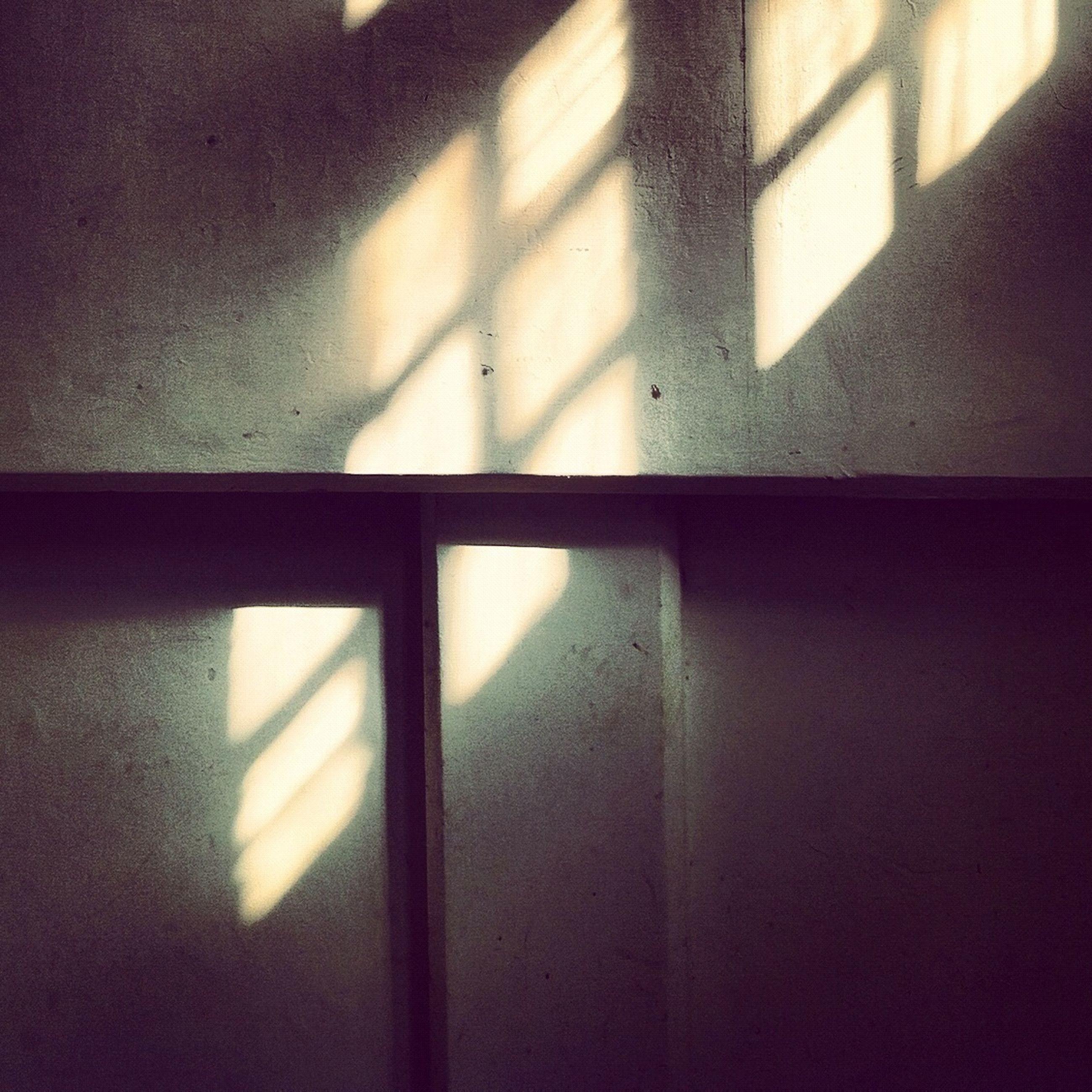 indoors, wall - building feature, window, home interior, architecture, built structure, wall, shadow, door, no people, house, close-up, domestic room, sunlight, closed, room, illuminated, flooring, pattern, day