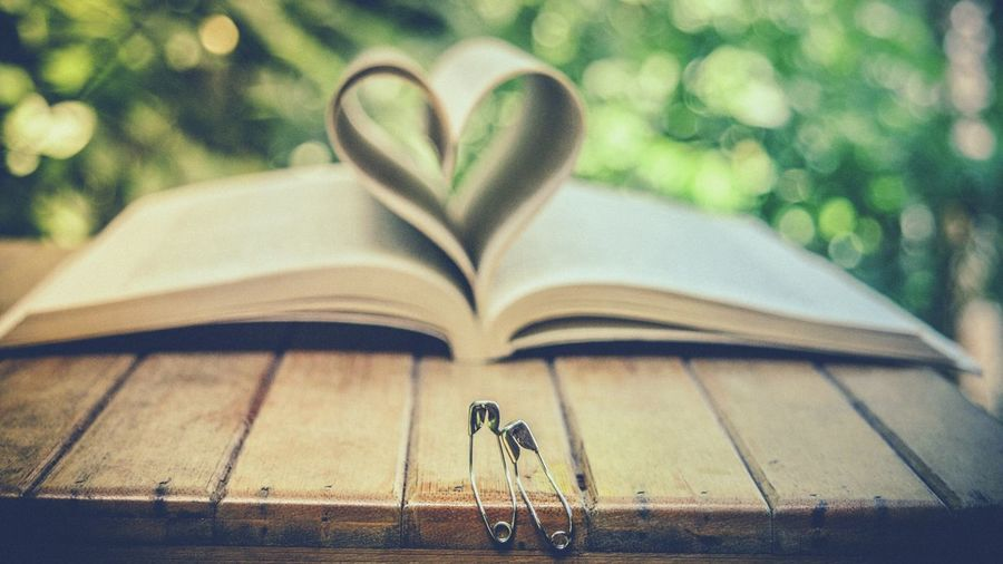 Pin love story Book Heart Shape Focus On Foreground Page Close-up No People Outdoors Day Nightphotography Photography Love Love ♥ Bokeh Photography Bokeh Heart ❤ eye EyeEm Best Shots EyEmNewHere EyeEm Gallery First Eyeem Photo Fresh On Eyeem  Eyemphotography Eyemgallery