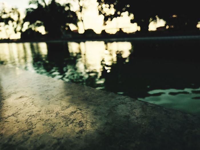 Surface level of lake at sunset