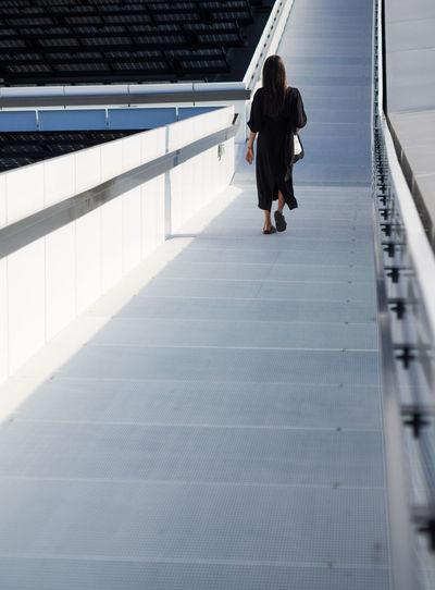Rear view of woman walking
