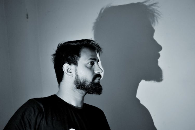 "touch of light in the dark...the shadow is fearless . ...""When you photograph a face ..you photograph the soul behind it""-Jean-Luc-Godard. Black & White Light And Shadow Portrait Perspective EyeEm Best Shots Indoors  EyeEm Selects People Beard Men Young Men Headshot Thoughtful Silhouette Posing Outline Calm Thinking Head And Shoulders"