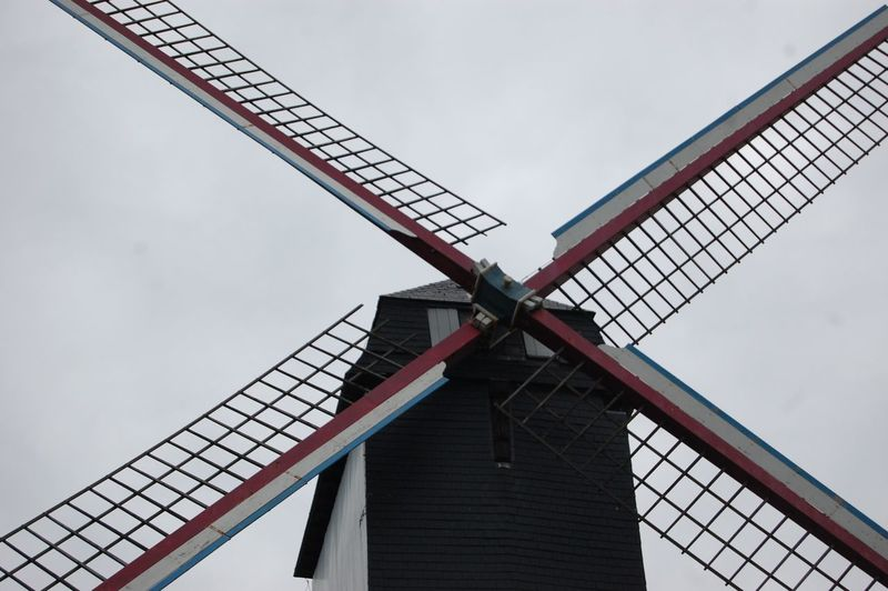 Low angle view of traditional windmill against sky