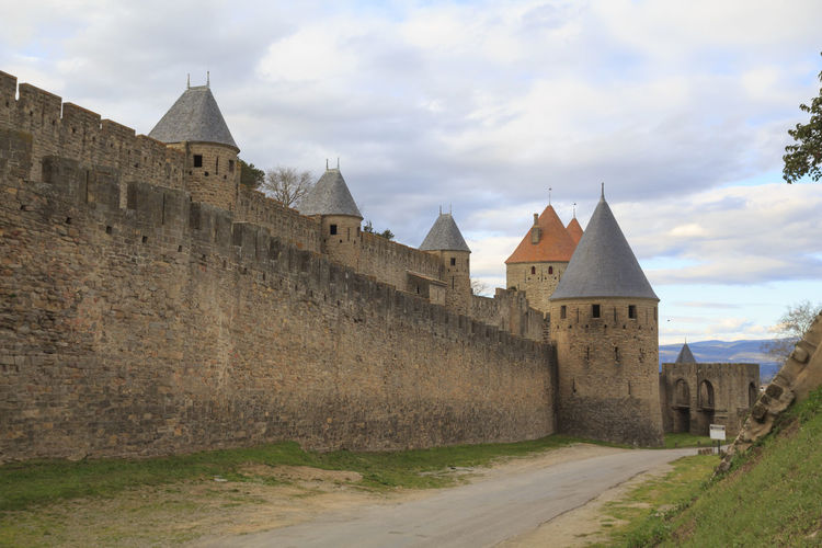 Carcassone medieval fortress Carcassonne France Architecture Building Exterior Built Structure Castle Day Defense Fort Fortification Fortress History Medieval Medieval Architecture Nature No People Old Outdoors Sky Stone Stone Wall The Past Tower Travel Destinations Wall