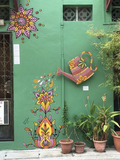 Close-up of multi colored graffiti on wall