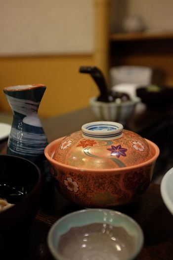 Ceramics bowls and container on restaurant table