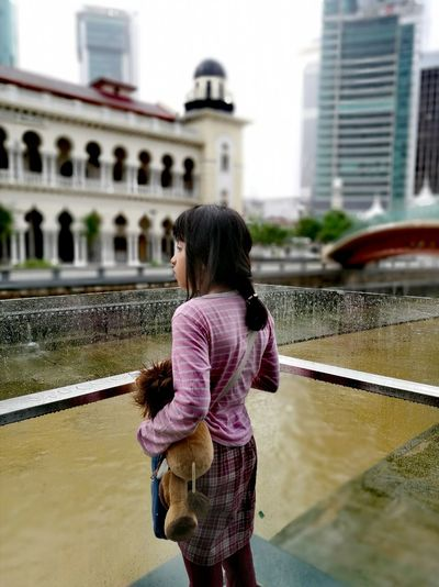Rear View Architecture Water One Person Standing Polluted Water Future Looking City After Rain