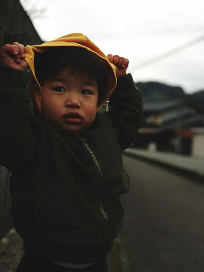 Portrait of boy wearing hat standing outdoors