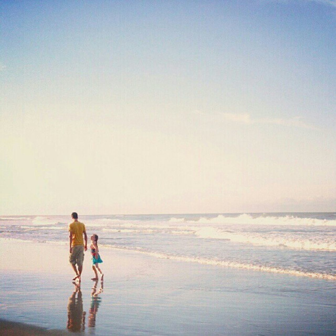 sea, beach, togetherness, horizon over water, vacations, bonding, walking, sky, love, leisure activity, full length, nature, childhood, two people, child, boys, wave, outdoors, sand, girls, scenics, standing, day, females, men, clear sky, adult, water, women, beauty in nature, people, young adult