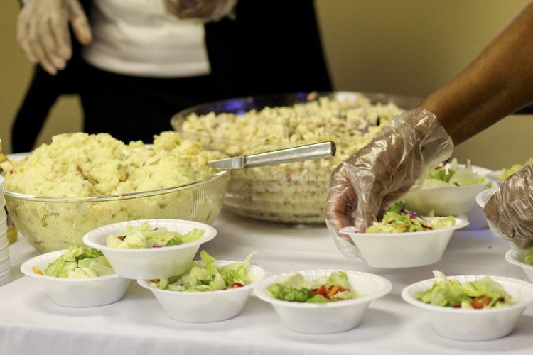 Cropped image of person preparing food