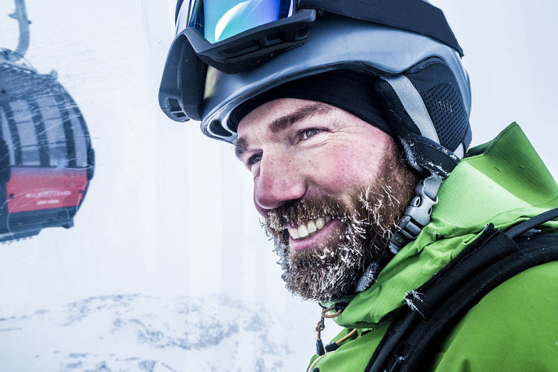 Close-up of smiling man wearing helmet