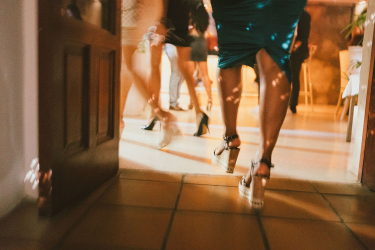 Pacha Clubbing Dress Fun Pacha Blurred Motion Day Enjoyment Excitement High Heels Human Leg Indoors  Leisure Activity Lifestyles Low Section Men Motion Nightclub Nightlife One Person People Real People Running Speed Togetherness Walking Fresh On Market 2017 HUAWEI Photo Award: After Dark