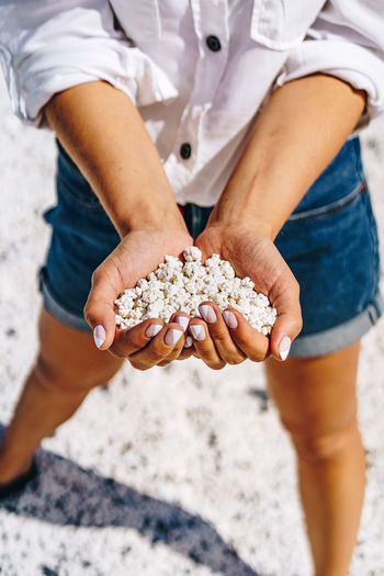 Popcorn Popcorns White Puffy Coral Shaped Stony Stones Little Tiny Small Beach Corralejo Fuerteventura Canary Islands Hand Hands Holding person Woman Girl Summer Ocean Atlantic Vibes Holidays Landscape Rocks Shore Coast SPAIN Vacation Natural Freedom Handful Travel Palms Volcanic  Elements