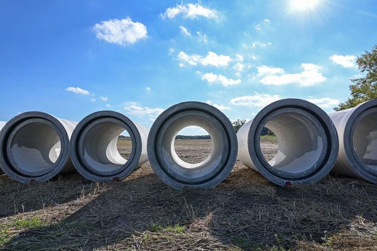 Full frame shot of pipes on field against sky