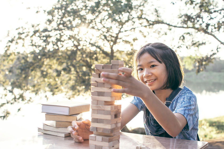 Stack Happiness Hobby Holding Lifestyles One Person Playing Smiling Tree