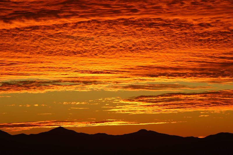 Look up Epic Peace Beauty Outdoors Orange Red Sunset Beauty In Nature Orange Color Scenics - Nature Sky Mountain Idyllic Nature Tranquility Dramatic Sky Sunlight Land Majestic Cloud - Sky Silhouette