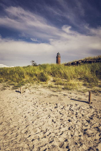 the hidden lighthouse Landscape Photography Abandoned Architecture Beach Beauty In Nature Building Exterior Built Structure Cloud - Sky Day Grass Landscape Landscape_photography Lighthouse Nature No People Outdoors Safety Sand Sand Dune Scenics Sea Sky Tranquil Scene Tranquility Water
