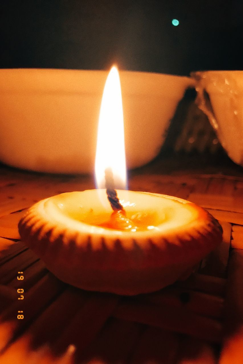 candle, heat - temperature, fire, flame, burning, illuminated, close-up, fire - natural phenomenon, indoors, no people, glowing, nature, orange color, christmas, lighting equipment, event, table, selective focus, food and drink, celebration, tea light, advent