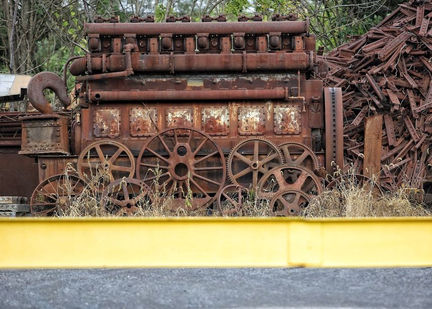 Old locomotive engine rusting in a Pennsylvania scrap yard of train parts. Train Train Engine JGLowe No People Architecture Day Design Metal Outdoors Nature Wall - Building Feature Transportation Plant Building Old Bench Wall Land Vehicle Art And Craft Mode Of Transportation