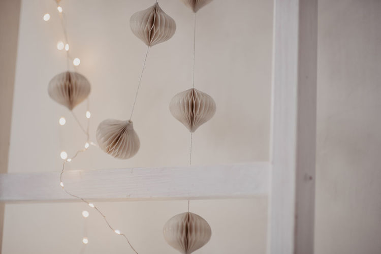 Low angle view of pendant lights hanging on ceiling at home
