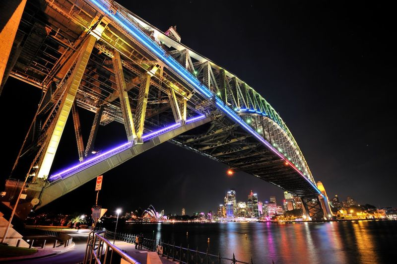 Low Angle View Of Illuminated Suspension Bridge At Night