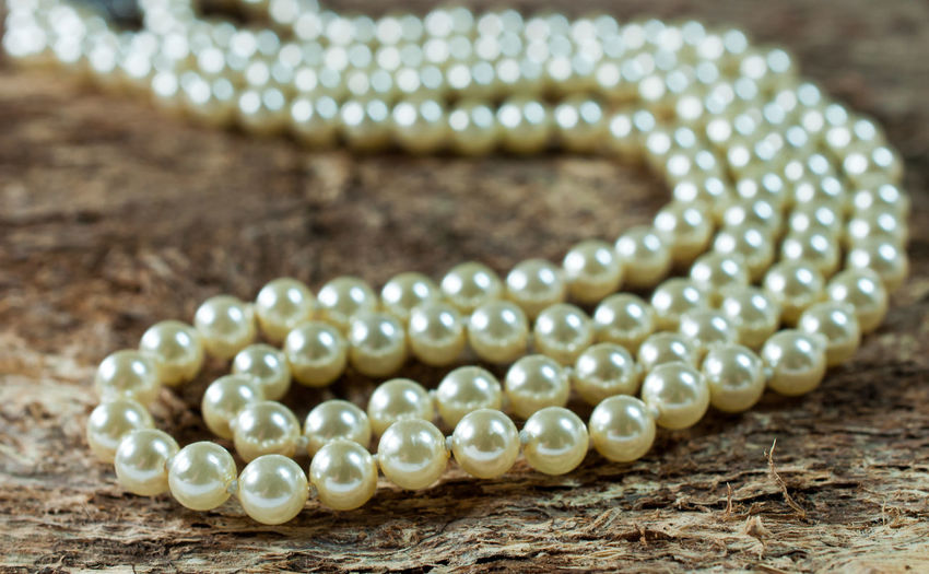 Close-up of pearl necklace on table