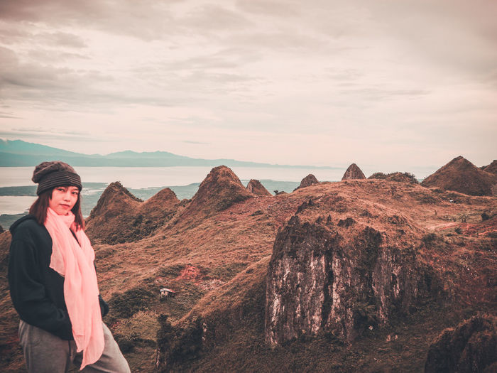 Exploring the unseen beauty of Cebu, Philippines. I've been exploring mountains since 2017 and i can say that this is one of the most beautiful mountain I have climbed so far. EyeEm Selects The Traveler - 2018 EyeEm Awards Young Women Warm Clothing Standing Eyeglasses  Mountain Scarf Redhead Sky Snowcapped Mountain Hiker Scenics