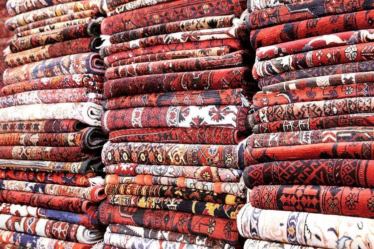 Full frame shot of folded blankets for sale in store