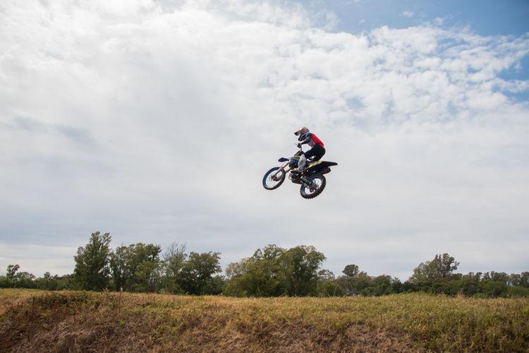 Motocross race rider jumping