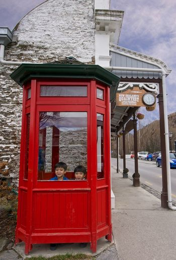 Chinese kids in phone box, Arrowtown, NZ. Arrowtown Arrowtown Phone Booth Arrowtown Phone Box Children Chinese Children Chinese Kids Cloud - Sky Cute Kids❤ Kids Main St, Arrowtown Nose Against Window Phone Booth Phone Box Red Telephone Booth The Past