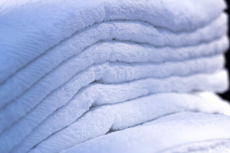White towels folded in order Backgrounds Full Frame Close-up Textured  Pattern No People Textile White Color Strength Winter Stack Towel Spiral Folded Indoors  Industry Metal Day Extreme Close-up Man Made Object Softness Textured Effect
