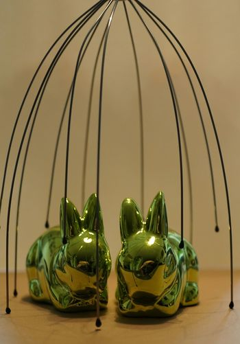 Green Shiny Easter Bunnies On Table At Home