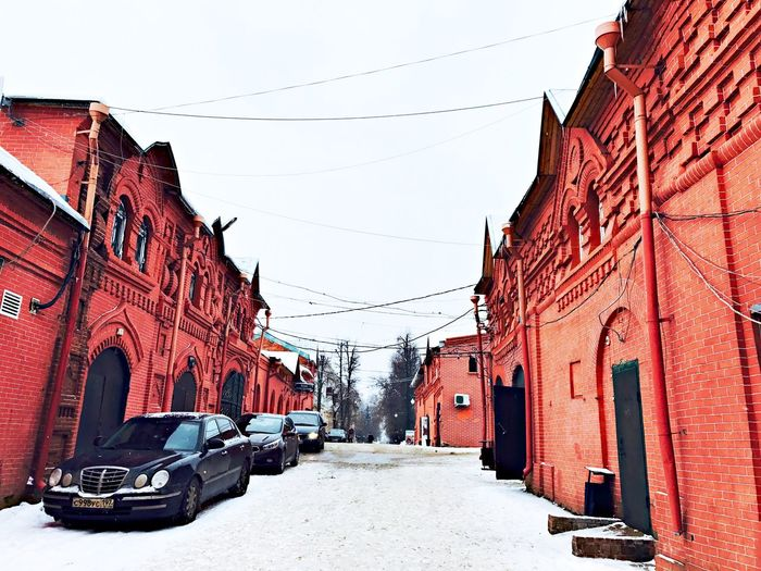 Provincial Town Province Small Town Red Building Red Building Exterior Car Architecture Snow Winter Outdoors Day Cold Temperature No People Road Clear Sky Built Structure Sky City Nature PhonePhotography Clam Finding New Frontiers Russia 3XSPUnity Traveling Home For The Holidays