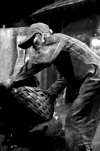 Making charcoal is a hard job Coolie Hard Old Photo Rural Tradition Black And White Photography Burn Wood Charcoal Close-up Day Full Length Heat Historical Kiln Labor Force Making Charcoal Men Nostalgia One Man Only One Person Outdoors People Real People Wood Burning