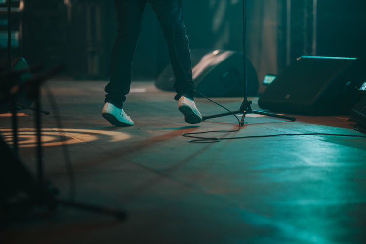 Low section of man standing on stage