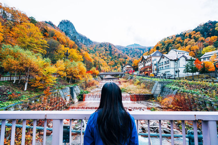 Daisetsuzan Change Autumn Real People Rear View Tree One Person Built Structure Architecture Building Exterior Plant Railing Lifestyles Nature Leisure Activity Day Women Long Hair Mountain Hair Outdoors Hairstyle Looking At View