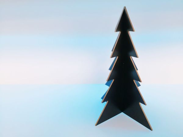 Triangle Shape No People Background Free Space For Text Backround Single Object Celebration Tradition Neutral Christmas Decoration Christmas Tree Christmas Colored Background Blue Studio Shot