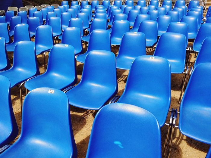 Blue Blue Color Plastic Neatly Arranged Neatly Organized Waiting Silence Tranquility Tranquil Scene Chair Auditorium Seat Blue Chair Stadium Full Frame Folding Chair Empty In A Row Arrangement Many Block Theater Conformity Repetition Seamless Pattern Side By Side