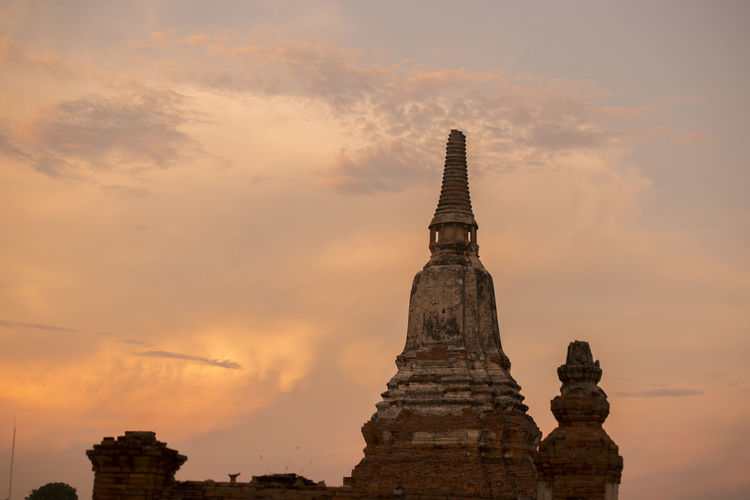 Low Angle View Of Wat Mahathat Against Sky During Sunset