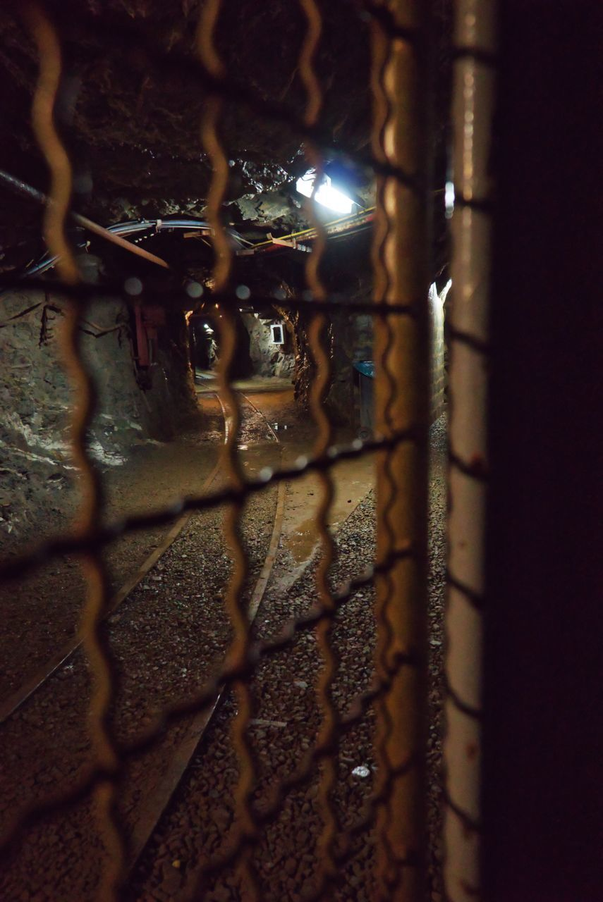 metal, no people, close-up, night, illuminated, selective focus, security, protection, safety, fence, indoors, lighting equipment, boundary, wall, pattern, wall - building feature, architecture, barrier, grate