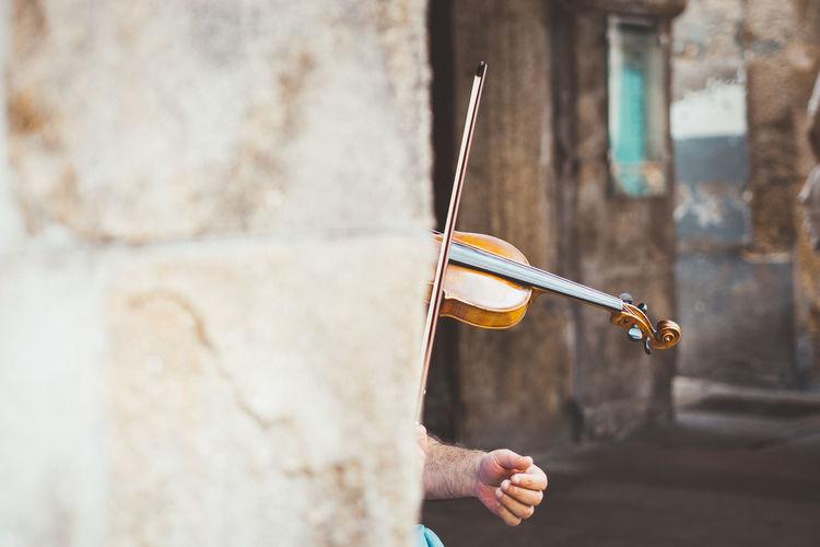 Cropped Image Of Man Playing Violin