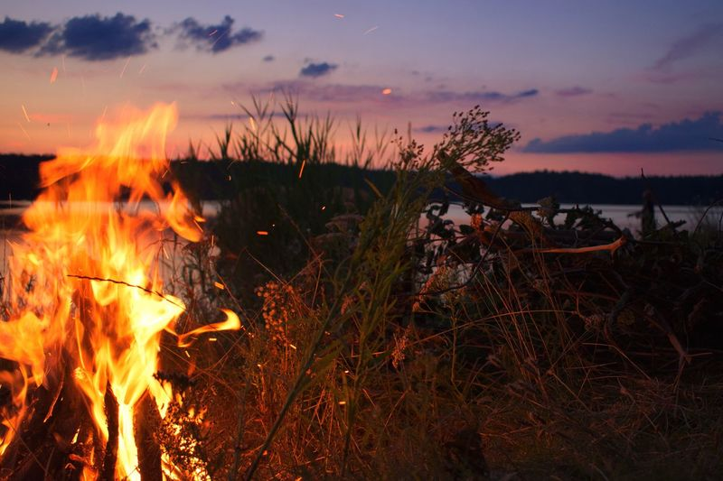 Sunset Burning Flame Nature Heat - Temperature Outdoors No People Sky Grass Bonfire Beauty In Nature Scenics Close-up